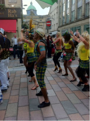 dancers in new Brazilian National Tartan by Clan Italia having a good time at festival in Glasgow